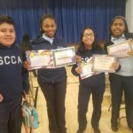 students with honor roll certificates